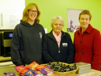 From Left to right Louise Leigh, Centre Operations Administrator,  Margaret Milkins, who has volunteered in the café for 16 years, and Davies and Partner' Legal Director, Suzanne Williams